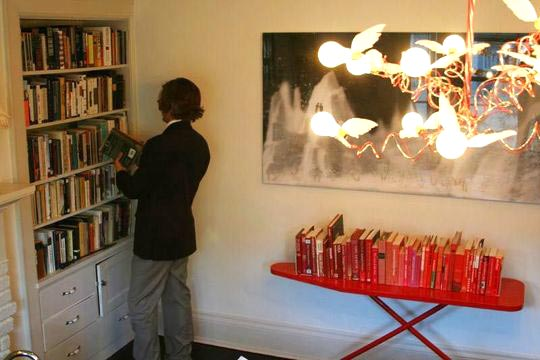 Red ironing board with red books, via Re-Nest