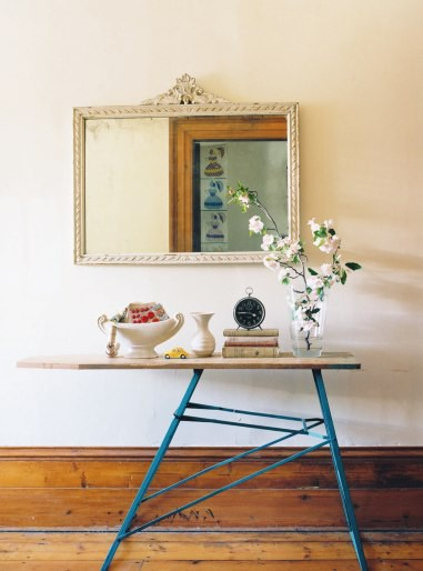 Ironing board with blue legs as a hall table