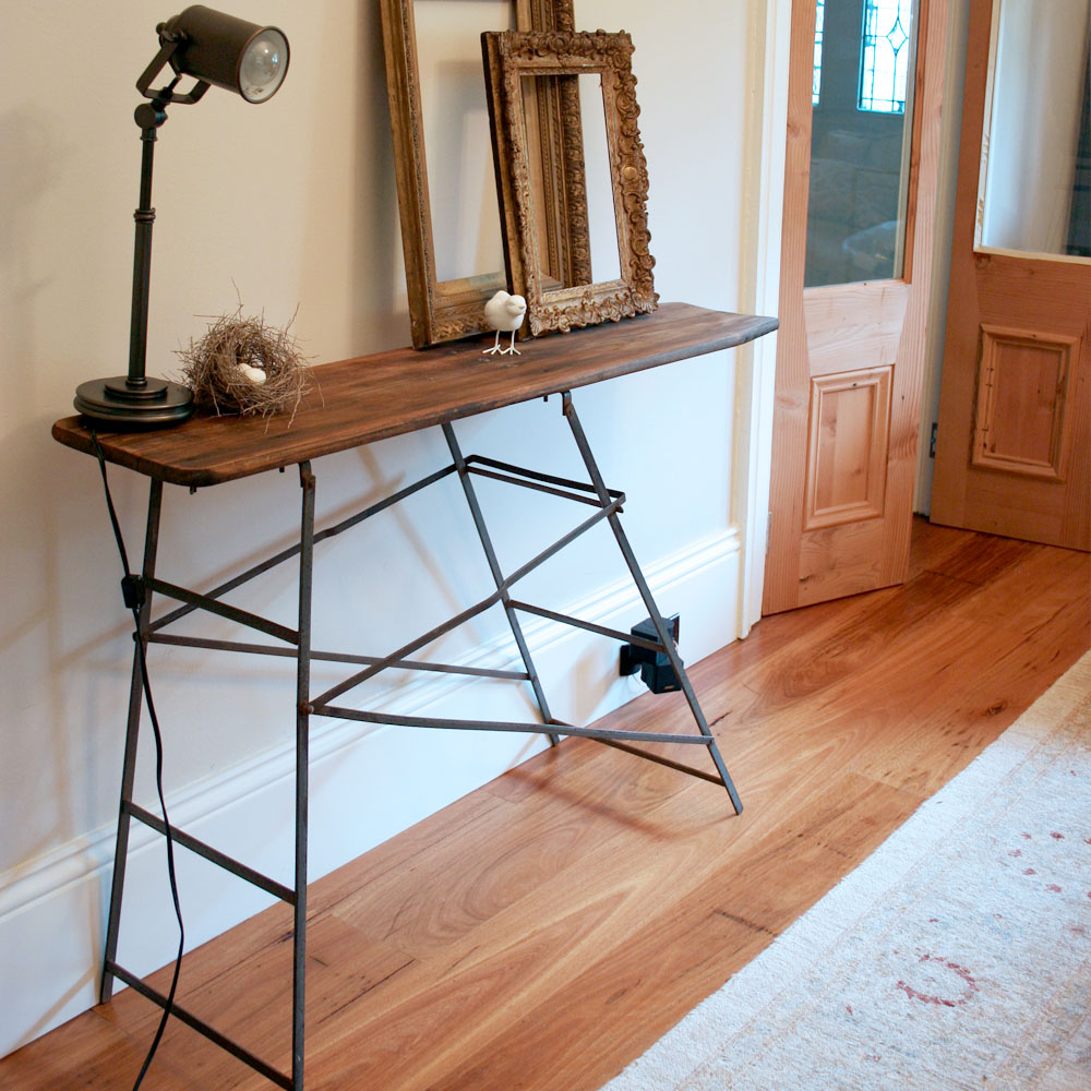 Ironing board as a side table, via Grins & Sighs