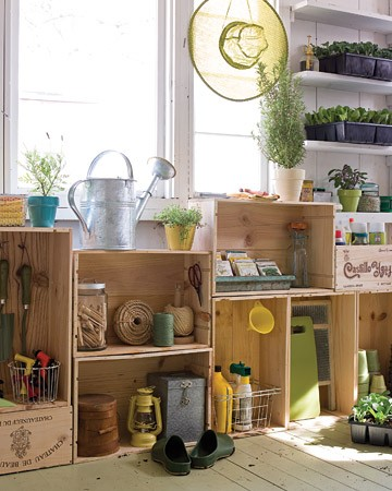 An organised potting bench using crates