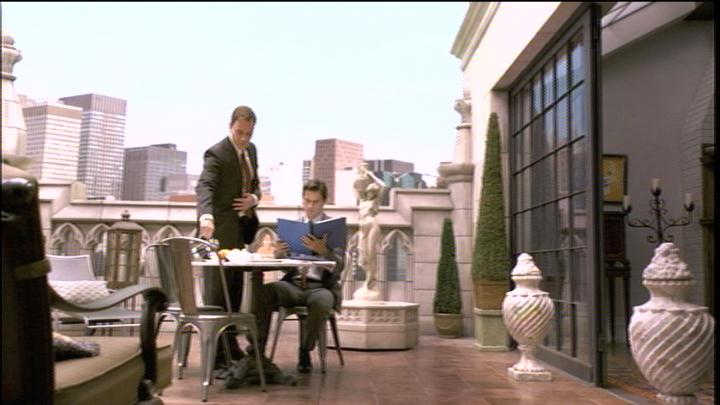 Neal and Peter out on the balcony in White Collar