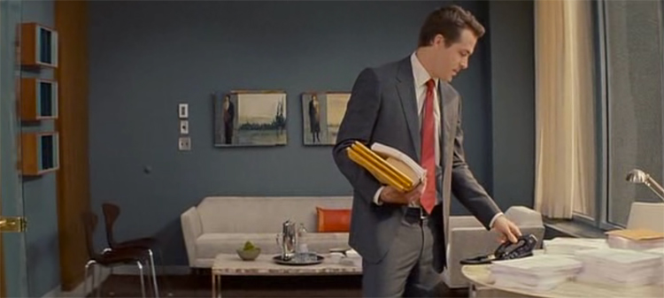 Ryan Reynolds looking spiffy in Margaret Tate's grey, orange and brown office, The Proposal.