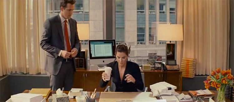 Ryan Reynolds and Sandra Bullock in Margaret Tate's grey, orange and brown office, The Proposal.