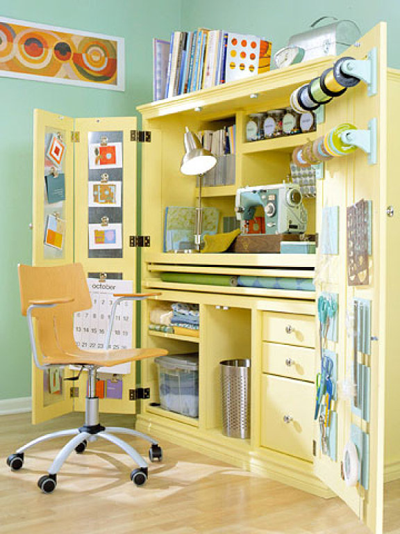 Pale yellow craft workstation in a cabinet, via Martha Stewart