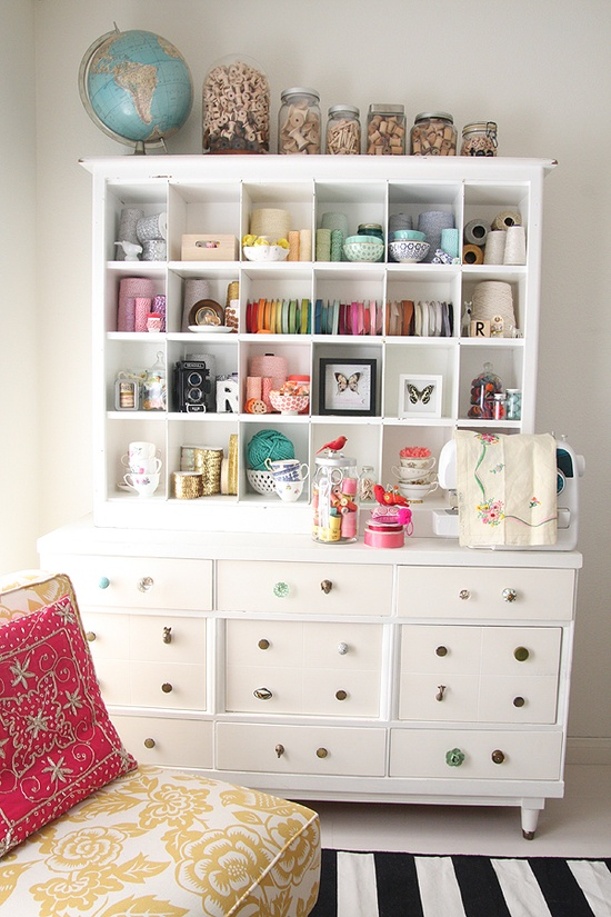 Large white dresser used as craft storage, via Pinterest