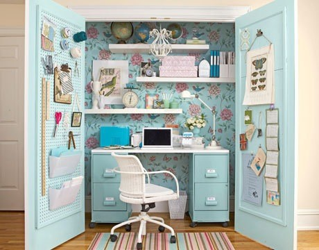 Craft storage in pale blue cabinet