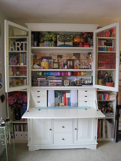 Tall white secretaire for craft storage, via Pinterest