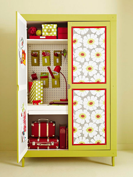 Wallpapered covered cabinet as pretty craft station, via Decorating Files