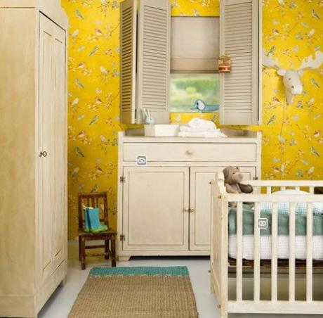 Nursery with white furniture and brilliant yellow floral wallpaper, via Boo Boo Ska