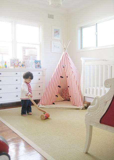 Red and white striped teepee in a bright white boys bedroom, via Ish and Chi