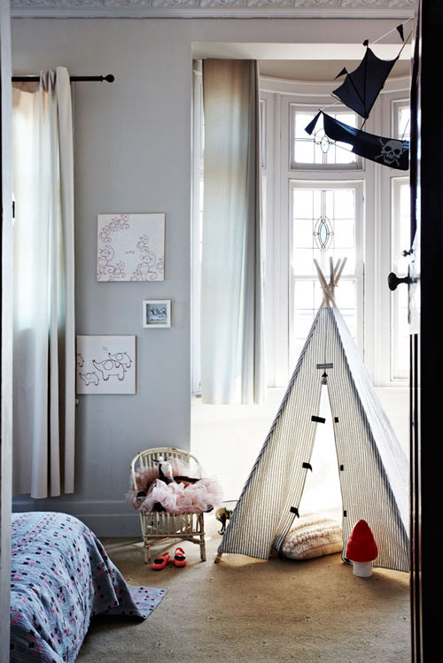 White teepee in gray bedroom, via Design Sponge