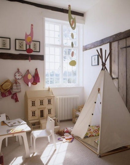 Teepee in sweet playroom with dollhouse, via Living Etc