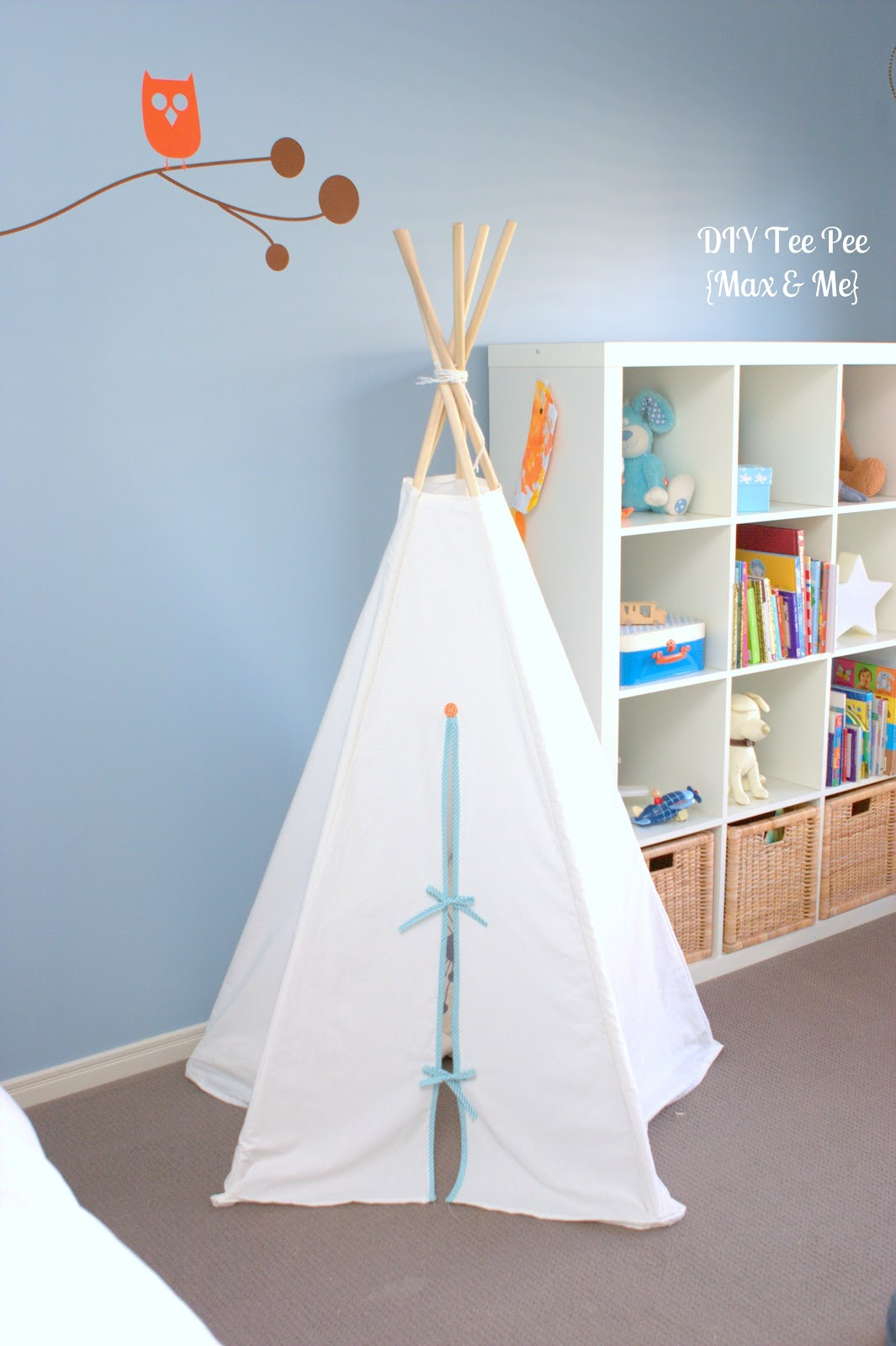 Simple white teepee in blue room, via max and me