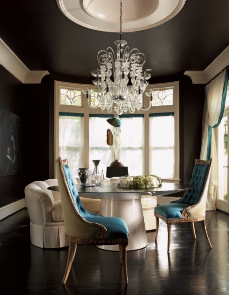 Black dining room with white trim and teal dining chairs, via forfur