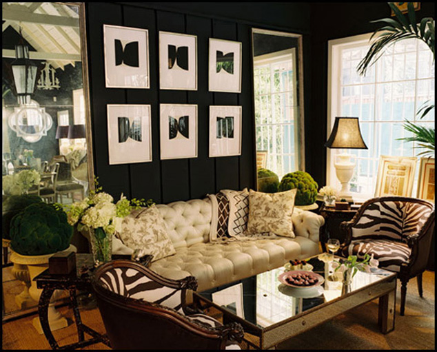Black living room with lots of golds and creams, via Divian Arts