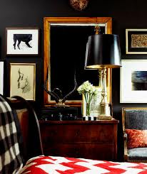 Black wall with wooden framed mirror, via Ruth Burt Interiors