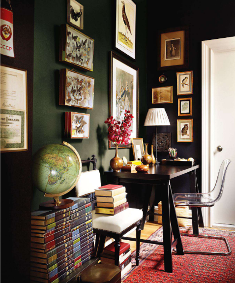 Black wall in corner against plenty of framed prints, via Ruth Burt Interiors