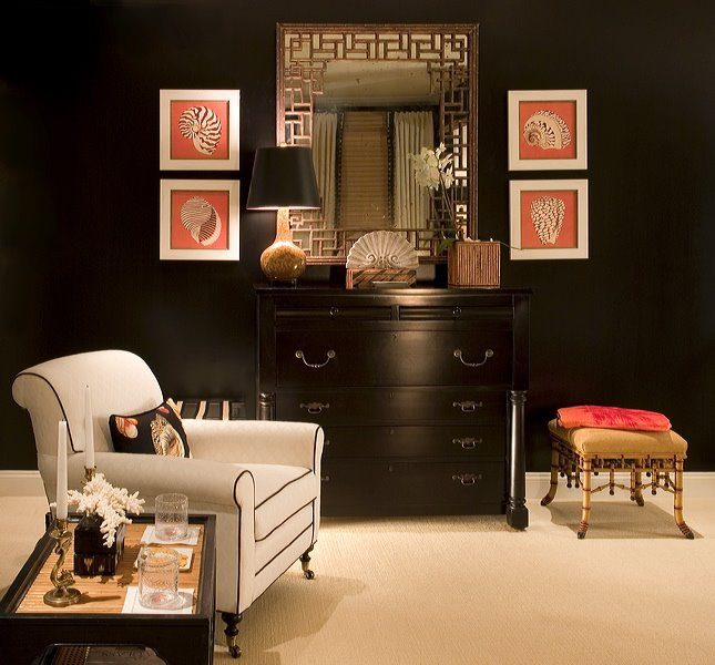 Black room with red strawberry accents and taupe rug, via Decor Chick