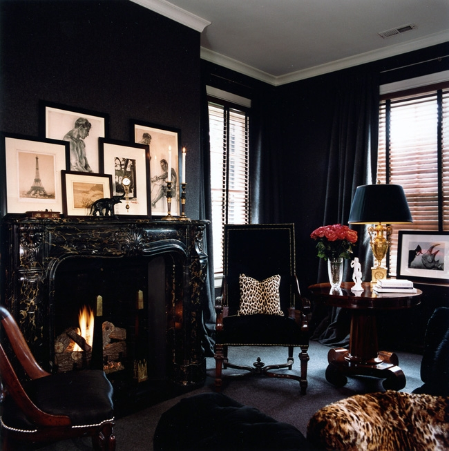 Black study with groups of cream prints on black mantlepiece, via the doppelgänger