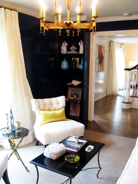Black room with gold chandelier and black flowy curtains, via Nest