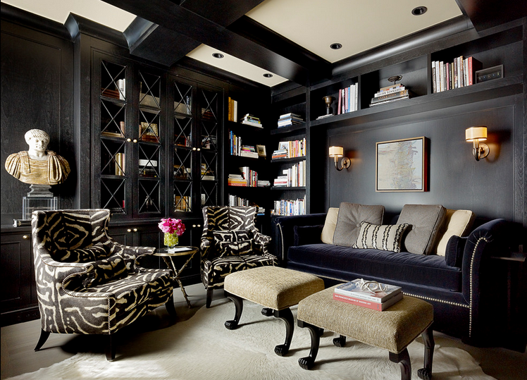 Black lined living space with library bookshelves, via Doryn Wallach