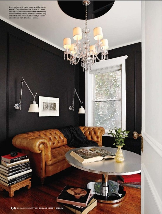 Black walls with cognac leather lounge, via indulgy