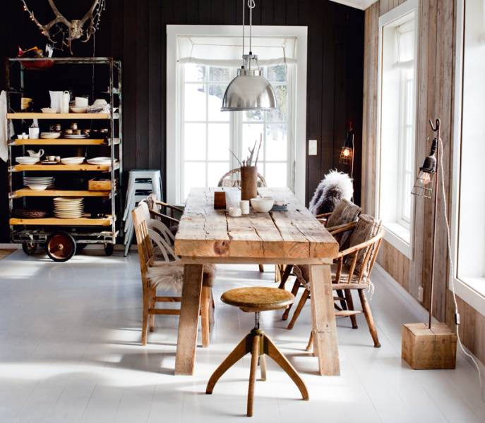 Black dining room with pale wooden dining table and chairs, via Trendey Blog