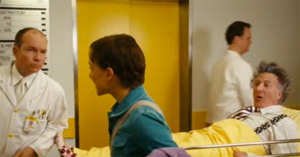 Natalie Portman and Dustin Hoffman in yellow elevator door, Mr Magorium's Wonder Emporium