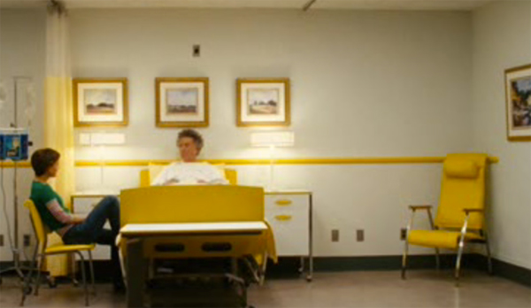Dustin Hoffman in yellow hospital bed with yellow chair, Mr Magorium's Wonder Emporium