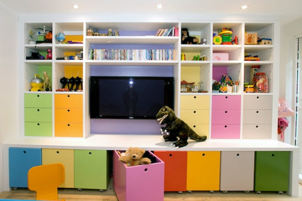 Brightly coloured drawer fronts in wall unit, via Mike Saville