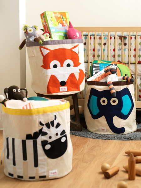 Fabric bins for toys with happy animals, via Lime Tree Kids