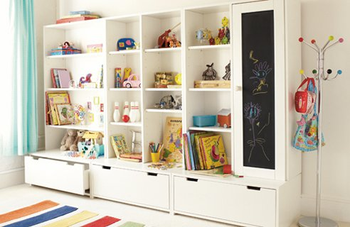 White wall unit to store toys and books