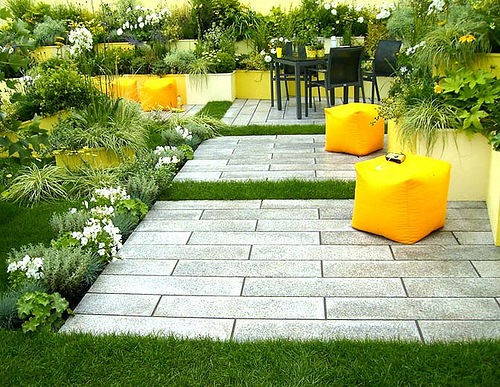 Courtyard with bright yellow stools, via Studio G