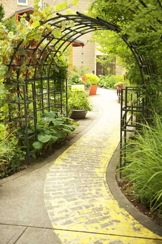 Yellow stamped path,  Legacy Emanuel Children's Hospital Garden, Portland, via Healing Landscapes