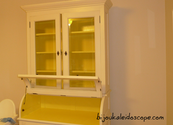 Closed white china cabinet, after