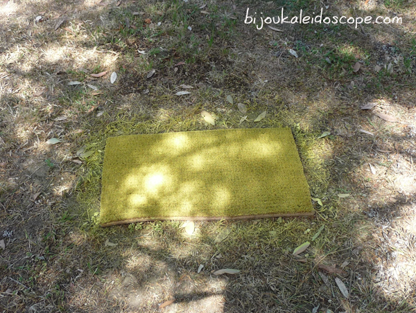 My coir mat being spray painted with Rust-Oleum's Sun Yellow