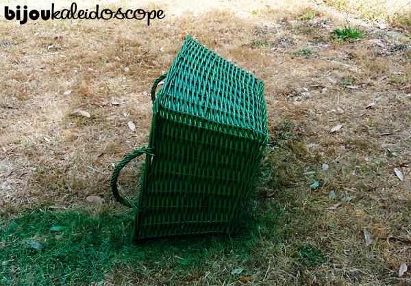 My wicker basket being spray painted Rust-O-leum® green