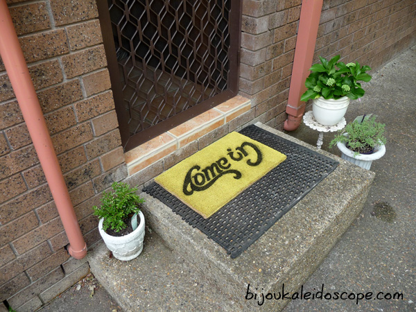 My new yellow ambigram coir mat in situ!