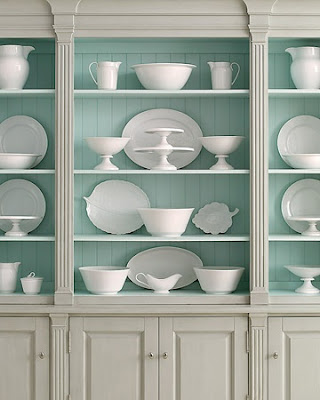Grey wall unit with blue insides, via Martha Stewart