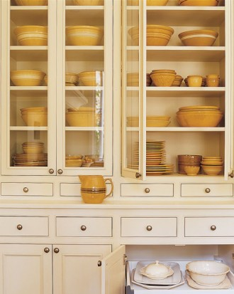 White wall unit with yellow dinnerware, via Martha Stewart