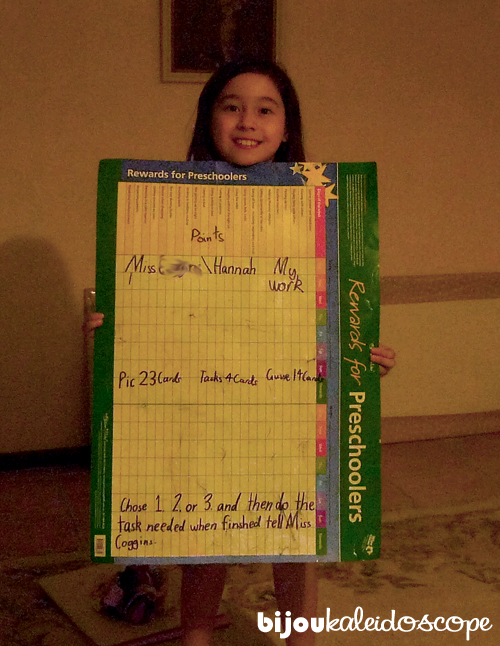 Hannah with her whiteboard poster chart and teacher instructions