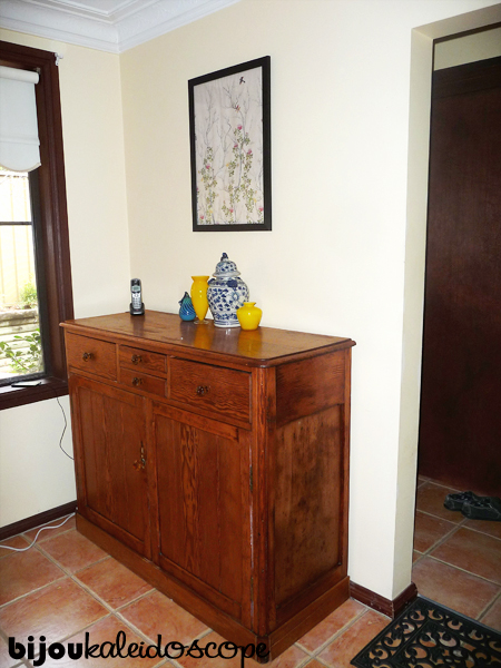 My new antique sideboard with the yellow, blue and white pieces.