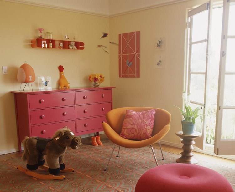 cheery pink, orange and red nursery with yellow walls, via Aqua Vitae Design