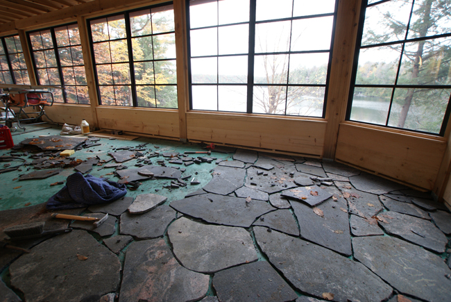 Laying local stone pavers in the Muskoka room  - Justin & Colin's Cabin Pressure
