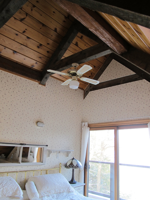 The gorgeous high roof in the one small upstairs bedroom before makeover - Justin & Colin's Cabin Pressure