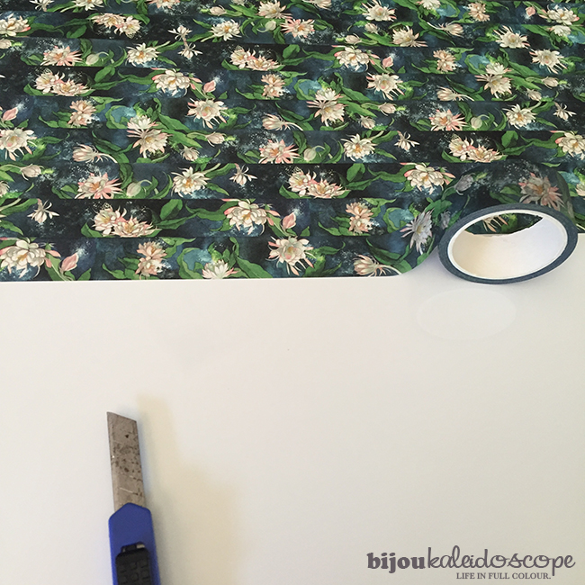 The washi tape I purchased being carefully placed on the whiteboard @bijoukaleidoscope