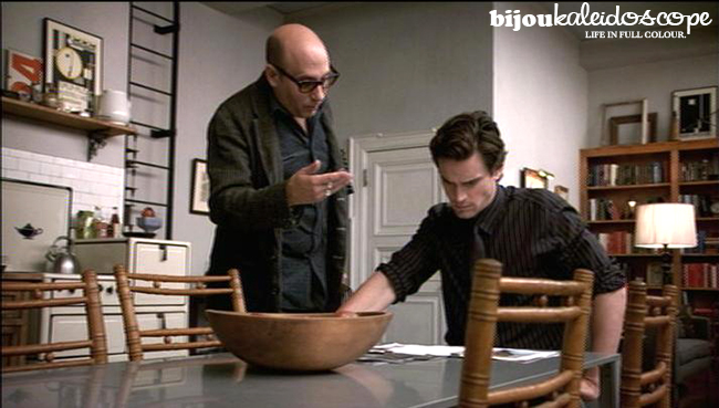 Mozzie and Neal confering at dining table, White Collar @bijoukaleidoscope