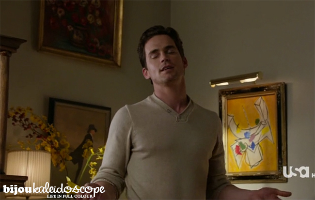Matt Bomer as Neal Caffrey with three artworks behind in in White Collar @bijoukaleidoscope
