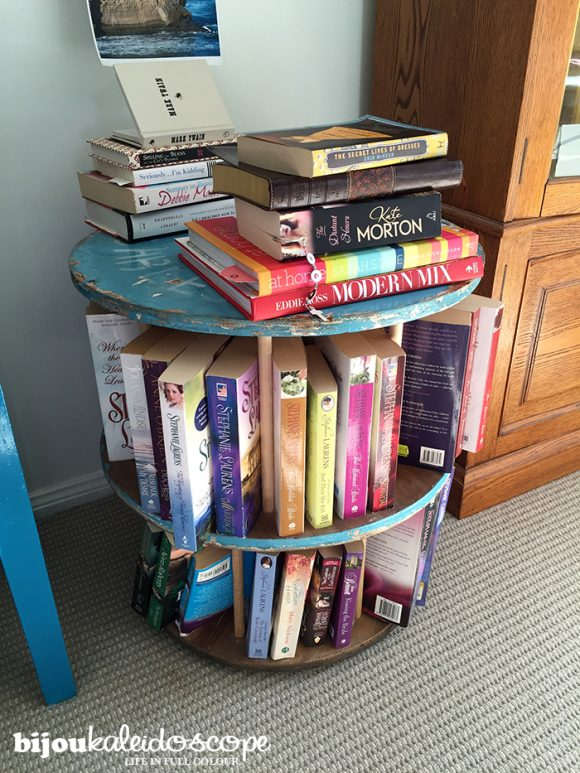 My rustic vibe cable reel bookcase, overflowing with my books! @bijoukaleidoscope