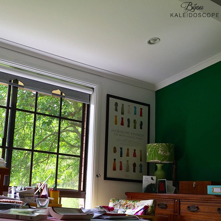 The corner of my bedroom with the large window and green and white walls